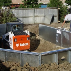 Excavating deep end and backfilling